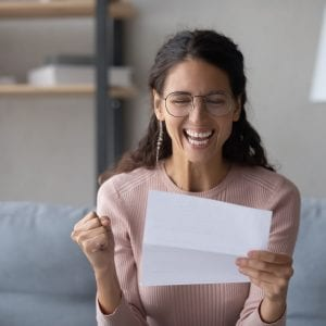 Win your health insurance for a year - woman celebrating
